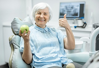 Senior woman smiling at dentist appointment