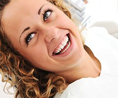 woman smiling with blonde curly hair