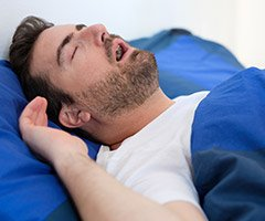 man snoring with mouth open