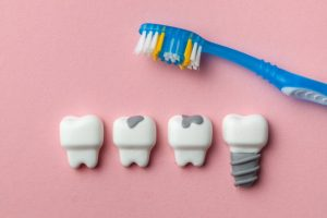 Toothbrush, teeth and dental implant