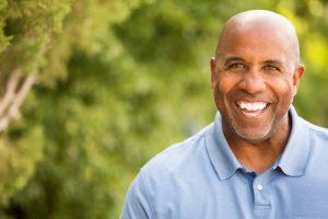older man smiling with dental implants